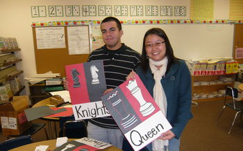 Mrs. Hom and Mr. Isaac are working hard to prepare for Chess Club.